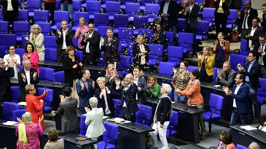 MPs from the Green party celebrate with confetti following a debate and vote on same-sex marriage in Bundestag, Germany´s lower house of Parliament in Berlin on June 30, 2017.
