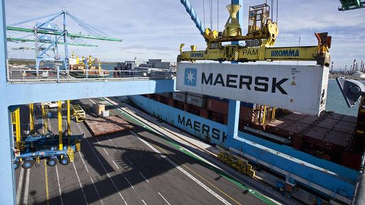 A crane loads a shipping container branded AP Moller-Maersk A/S onto the freight ship. The company fell victim to a widespread cyberattack on June 27, 2017.