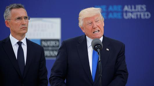 President Donald Trump speaks beside NATO Secretary General Jens Stoltenberg at the start of the NATO summit at their new headquarters in Brussels, Belgium, May 25, 2017.