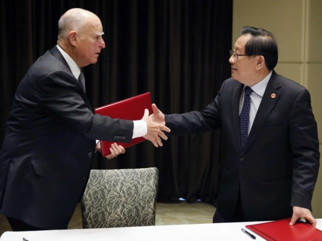 Jerry Brown China agreement (Andy Wong / Associated Press)