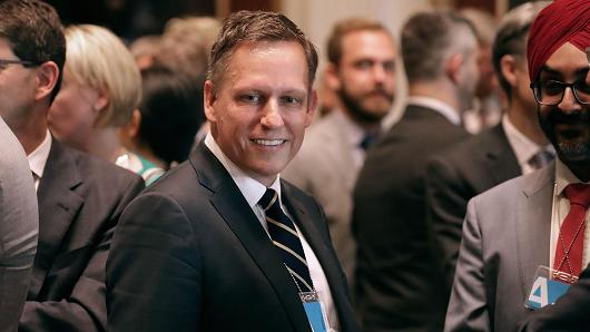 Venture capitalist Peter Thiel of the Founders Fund and other technology executives and leaders attend the inaugural meeting of the American Technology Council in the Indian Treaty Room at the Eisenhower Executive Office Building next door to the White House June 19, 2017 in Washington, DC.