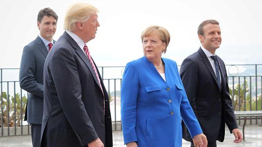 Justin Trudeau, Donald Trump, Angela Merkel and Emmanuel Macron at the G7 Taormina summit on the island of Sicily on May 26, 2017 in Taormina, Italy.