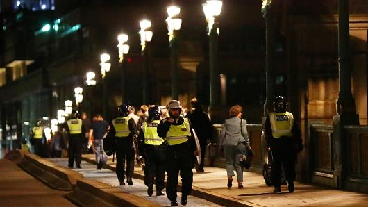 Police officers cross Southwark Bridge after an incident near London Bridge in London, Britain June 4, 2017.