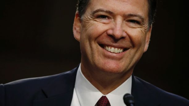 Former FBI Director James Comey testifies before a Senate Intelligence Committee hearing on