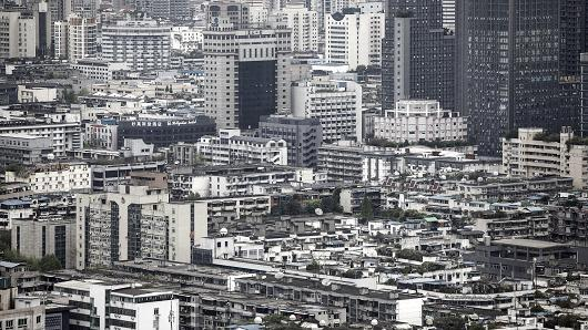 Residential and commercial buildings stand in Chengdu, China, on Monday on April 10, 2017.