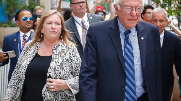 FILE--In this July 28, 2016 file photo, Sen. Bernie Sanders, I-Vt. and his wife Jane walk through downtown in Philadelphia during the final day of the Democratic National Convention. Sanders and his wife Jane O'Meara Sanders have hired lawyers in the face of federal investigations into the finances of the now-defunct Burlington College, which closed last year due, many feel, to debts incurred when Jane Sanders entered into an ill-advised real estate deal. (AP Photo/John Minchillo, File)