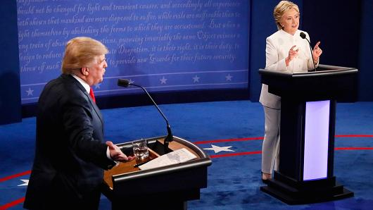 Republican presidential nominee Donald Trump listens as Democratic presidential nominee Hillary Clinton speaks during their third and final 2016 presidential campaign debate at UNLV in Las Vegas, October 19, 2016.