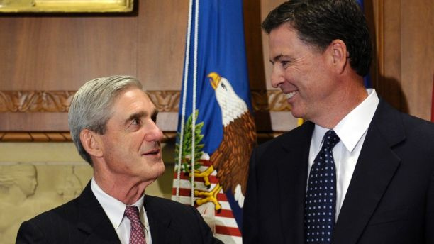 FILE - In this Sept. 4, 2013, file photo, then-incoming FBI Director James Comey talks with outgoing FBI Director Robert Mueller before Comey was officially sworn in at the Justice Department in Washington.  On May 17, 2017, the Justice Department said it is appointing Mueller as special counsel to oversee investigation into Russian interference in the 2016 presidential election. (AP Photo/Susan Walsh, File)