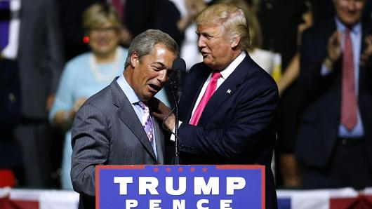 Donald Trump, right, greets United Kingdom Independence Party leader Nigel Farage during a campaign rally at the Mississippi Coliseum on August 24, 2016 in Jackson, Mississippi.