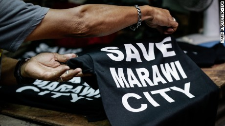 """""""Save Marawi City"""" T-shirts are sold in Manila to help  victims of the fighting."""