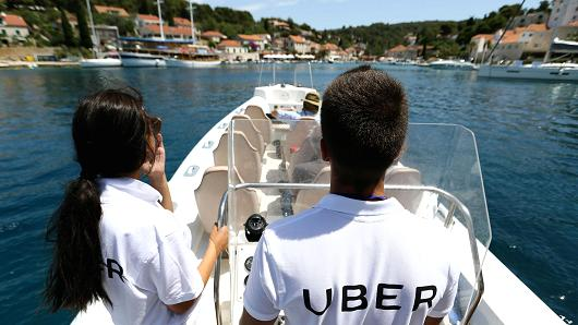 Crew members from UberBOAT on a boat at the Adriatic sea on the island of Solta, Croatia, June 30, 2017.