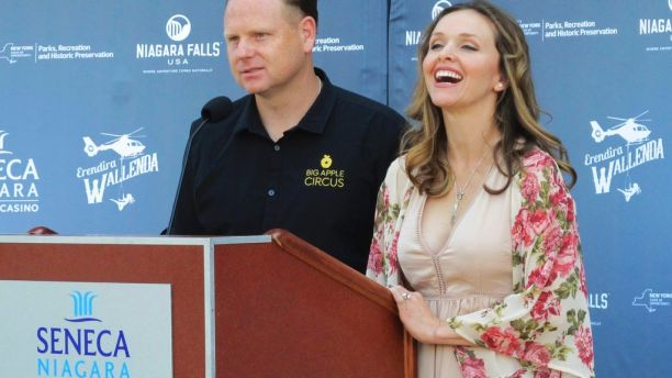Trapeze-artist Erendira Wallenda smiles as she and her daredevil husband Nik Wallenda describe Erendira's plans to perform an acrobatic routine while suspended from a helicopter above Niagara Falls, at a news conference Wed., June 14, 2017 at the Seneca Niagara Casino in Niagara Falls, N.Y. The stunt is planned for Thursday, June 15, the fifth anniversary of Nik Wallenda's televised 1,800-foot tightrope walk from the New York side of Niagara Falls into Canada. (AP Photo/Carolyn Thompson)
