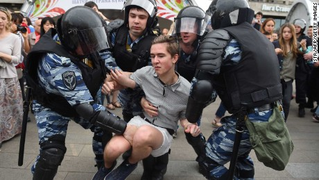 Police detain a protester in Moscow on Monday.