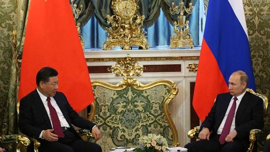 Russian President Vladimir Putin (R) listens to Chinese President Xi Jinping (L) during their meeting at the Grand Kremlin Palace on July 4, 2017 in Moscow, Russia.