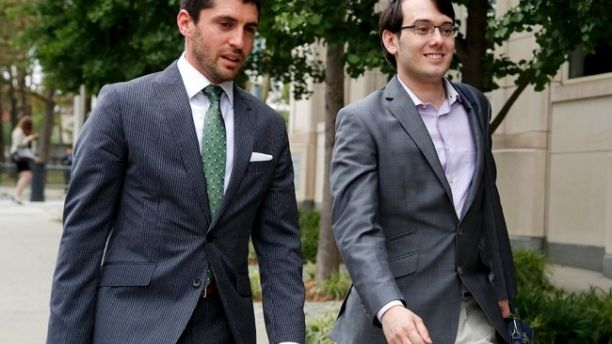 Former biotech CEO Martin Shkreli, right, leaves federal court with a member of his legal team Thursday, July 27, 2017, in New York. Shkreli's defense attorney, Benjamin Brafman, told the jury during closing arguments that his client annoyed some of his investors but ultimately rewarded them by starting a drug company that doubled or tripled their money. (AP Photo/Julie Jacobson)