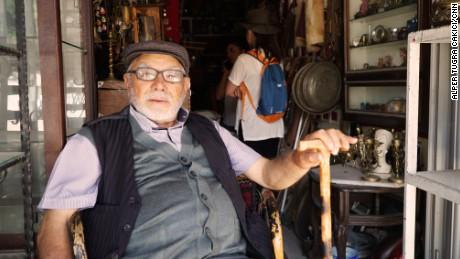 Ismet Sinaktas takes a rest outside an antiques shop in Ankara.