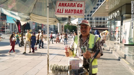 Mahmut Sahin sells lottery tickets in Kizilay square.