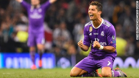 Ronaldo falls to his knees as he celebrates Real's victory in the UEFA Champions League final against Juventus