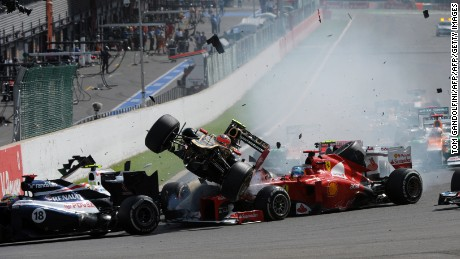 Romain Grosjean's Lotus car narrowly avoids Fernando Alonso at the 2012 Belgium Grand Prix.