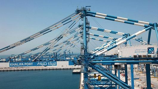 Cranes stand on the quayside at Khalifa Port on April 26, 2012.