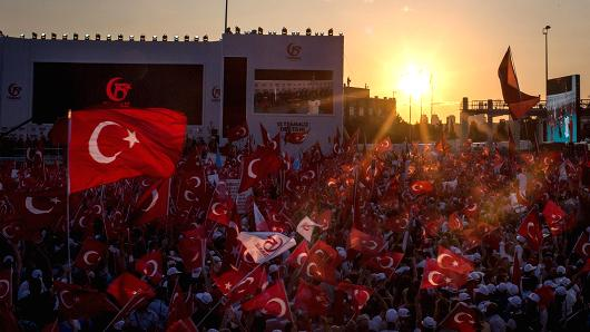 Istanbul, July 15 2017: People chant slogans and wave flags at the first anniversary of the July 15, 2016 failed coup attempt.