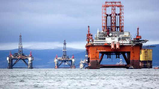 The West Phoenix oil platform, operated by Seadrill Norge AS, right, stands with other unused platforms in the Port of Cromarty Firth in Cromarty, U.K.