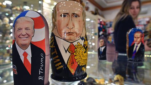 Traditional Russian wooden nesting dolls, Matryoshka dolls, depicting US President-elect Donald Trump (L) and Russian President Vladimir Putin are seen at a gift shop in central Moscow on January 16, 2017