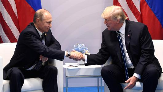 US President Donald Trump and Russia's President Vladimir Putin shake hands during a meeting on the sidelines of the G20 Summit in Hamburg, Germany, on July 7, 2017.