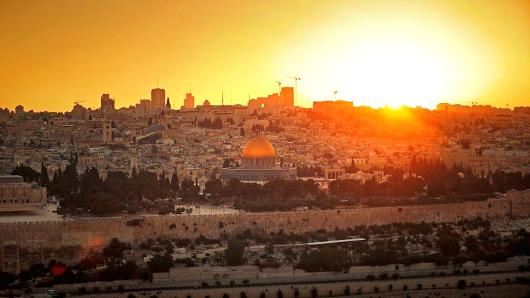 The sun sets over Jerusalem's Old City on July 8, 2017, as seen from the Mount of Olives.
