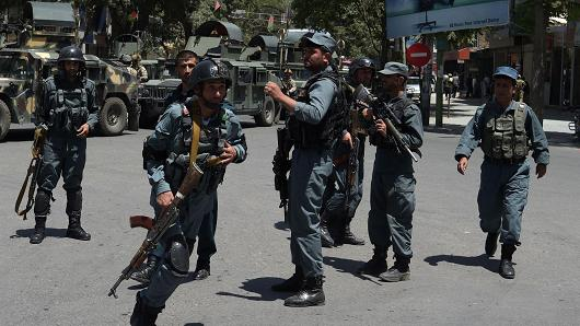 Afghan policemen arrive at the site of a suicide blast near Iraq's embassy in Kabul on July 31, 2017.