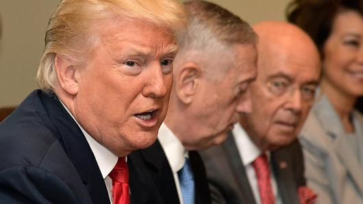 President Donald Trump makes remarks during a meeting of his cabinet, including (L-R) Defense Secretary James Mattis, Commerce Secretary Wilbur Ross and Transportation Secretary Elaine Chao at the White House on July 31, 2017 in Washington, DC.