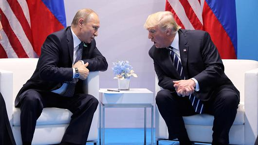 President Donald Trump speaks with Russian President Vladimir Putin during the their bilateral meeting at the G20 summit in Hamburg, Germany July 7, 2017.