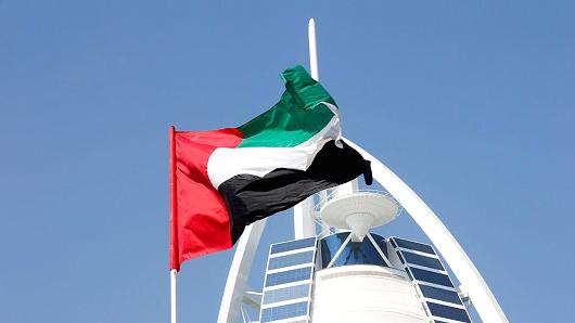 The Burj Al Arab with the flag of the United Arab Emirates in Dubai, UAE.