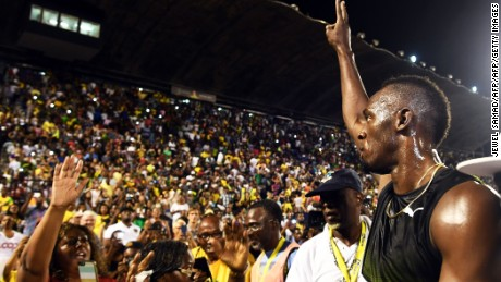 Bolt salutes the crowd after running his final race in Jamaica
