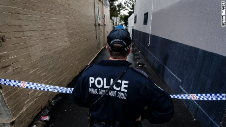 A Police officer watches over an ongoing operation in Surry Hills on July 31, 2017 in Sydney, Australia.