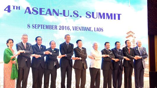 Participant leaders pose for a photograph during the closing ceremony at the 28th and 29th ASEAN Summits and Related Summits at the National Congress Center in Vientiane, Laos on September 8, 2016.