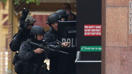 Armed police are seen outside the Lindt Cafe, Martin Place on December 15, 2014 in Sydney, Australia.
