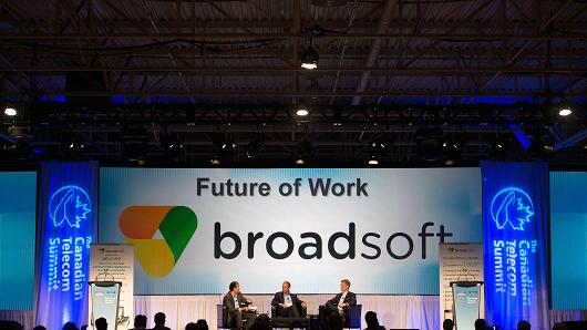 Taher Behbehani, chief marketing officer of Broadsoft Inc., from left, Charlie Wade, senior vice president of products and solutions at Rogers Communications Inc., and Ron McKenzie, senior vice president of Shaw Communications Inc., participate in a panel discussion at the Canadian Telecom Summit in Toronto, Ontario, Canada, on Monday, June 6, 2016.
