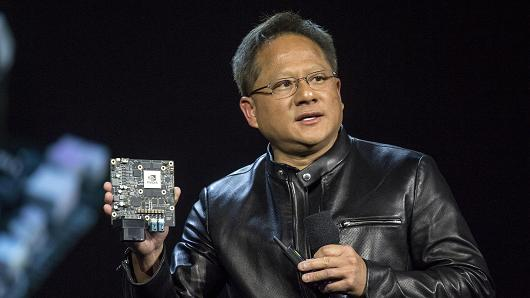 Jen-Hsun Huang, president and chief executive officer of Nvidia Corp., holds the Nvidia Xavier high-end computing module as he speaks during a keynote presentation at the 2017 Consumer Electronics Show (CES) in Las Vegas, Nevada, U.S., on Wednesday, Jan. 4, 2017.