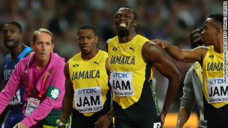 The agony is clear for all to see as Bolt of Jamaica is comforted by teammates.