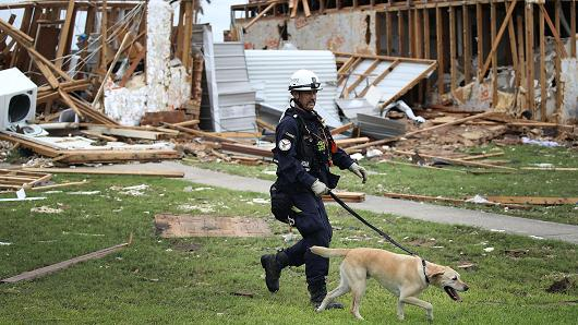 Robert Grant and Rocky from the Texas Task Force 2 search and rescue team work through a destroyed apartment complex trying to find anyone that still may be in the apartment complex after Hurricane Harvey passed through on August 27, 2017 in Rockport, Texas.
