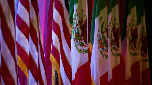 American flags, left, stand next to Mexican flags ahead of the first round of North American Free Trade Agreement (NAFTA) renegotiations in Washington, D.C., U.S., on Wednesday, Aug. 16, 2017.