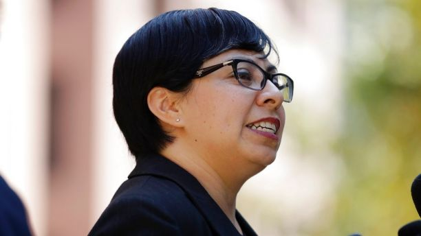 Lawyer Nora Preciado speaks to reporters after a hearing on whether a Mexican who was shielded from being deported through the Deferred Action for Childhood Arrivals program was wrongly expelled from the United States, Tuesday, Aug. 22, 2017, in San Diego. U.S. District Judge Gonzalo Curiel suggested Tuesday that he wanted to go straight to trial on the case of 23-year-old Juan Manuel Montes. Montes claims immigration authorities forcibly removed him from the United States after midnight on Feb. 19. The Trump administration says Montes left the country voluntarily, forfeiting his protected status. (AP Photo/Gregory Bull)