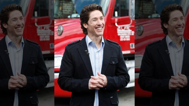 The Rev. Joel Osteen smiles at a food distribution site for Feed The Children in New York April 23, 2009. The distribution site was set up for employees laid off  from hotel and restaurant jobs affected by a drop in tourism.    REUTERS/Shannon Stapleton   (UNITED STATES SOCIETY RELIGION BUSINESS) - RTXEB2Y