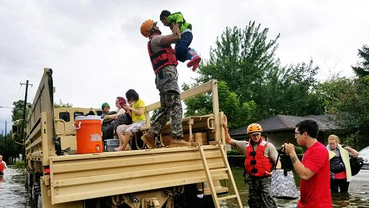 Texas National Guard soldiers aid residents in heavily flooded areas in Houston, August 27, 2017.