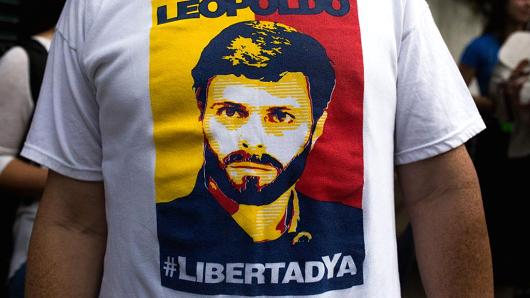 A supporter wears a T-shirt with the likeness of opposition leader Leopoldo Lopez while waiting for his release from jail in Caracas, Venezuela, on July 8, 2017.