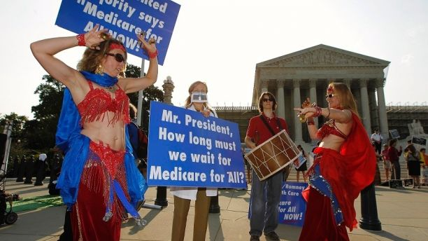 Belly dancers calling for single payer national health insurance perform outside the Supreme Court in Washington, June 28, 2012. The Supreme Court is set to deliver on Thursday its ruling on President Barack Obama's 2010 healthcare overhaul, his signature domestic policy achievement, in a historic case that could hand him a huge triumph or a stinging rebuke just over four months before he seeks re-election. REUTERS/Jason Reed  (UNITED STATES - Tags: POLITICS HEALTH) - RTR34A4N
