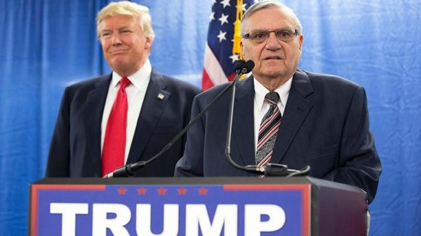 FILE - In this Jan. 26, 2016, file photo, then-Republican presidential candidate Donald Trump is joined by Joe Arpaio, the then sheriff of metro Phoenix, during a news conference in Marshalltown, Iowa. Trump isn't expected to take action Tuesday, Aug. 22, 2017, on a possible pardon of Arpaio's conviction for intentionally disobeying a judge's order in an immigration case. White House press secretary Sarah Huckabee Sanders told reporters that the president would take no action Tuesday on Arpaio as Trump plans to appear in the evening at a rally in downtown Phoenix. (AP Photo/Mary Altaffer, File)