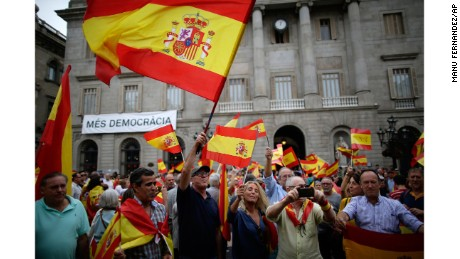 People wave Spanish flags while demonstrating against Catalonia's independence referendum in Barcelona on Saturday.