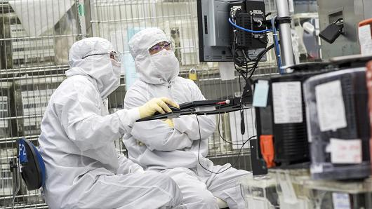 Technicians work on machinery at the Applied Materials facility in Santa Clara, California.
